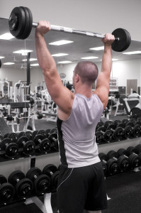 15395-a-healthy-young-man-lifting-weights-in-a-gym-pv
